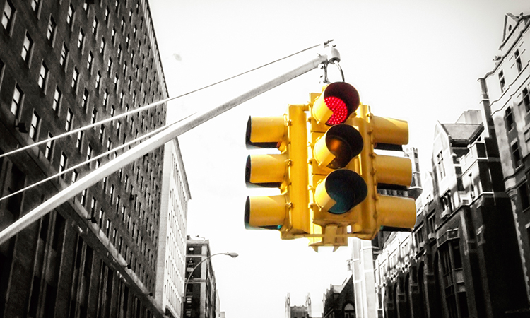 Red stop light in city