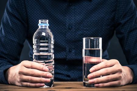 man-drinking-water-to-pass-drug-test